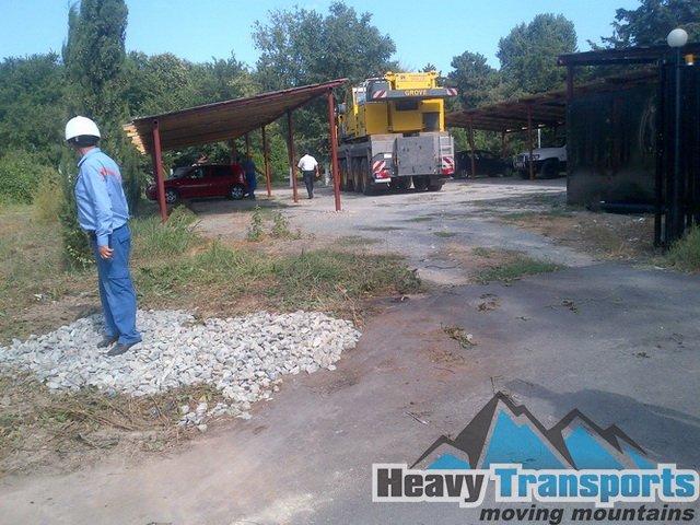 Transportul unui transformator electric industrial: am folosit o automacara pentru încărcarea pe platformă a componentei